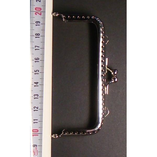 Boquilla Monedero 3x10 cm.
