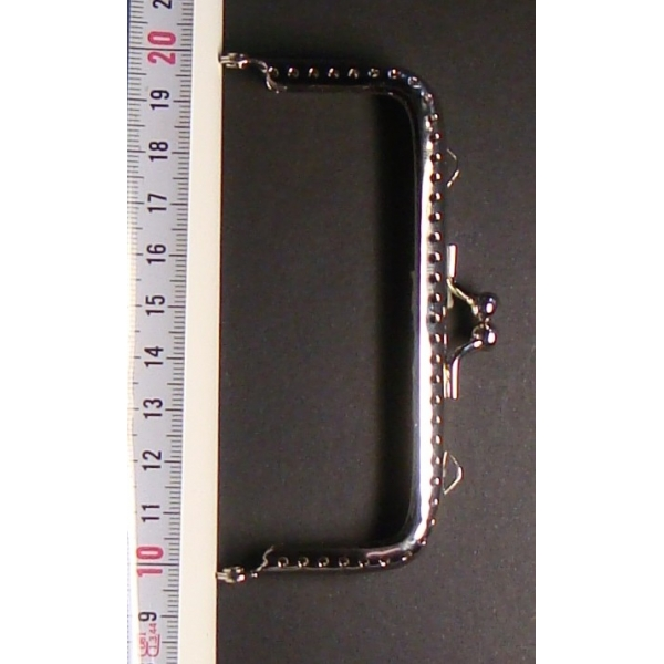 Boquilla Monedero 5x10 cm.